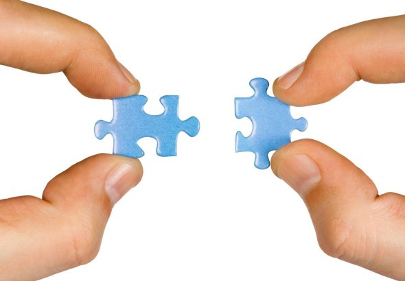 two-hands-each-with-blue-puzzle-piecex