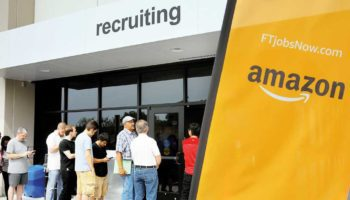 "FILE PHOTO: Job seekers line up to apply during ""Amazon Jobs Day"" at the Amazon.com Fulfillment Center in Fall River"