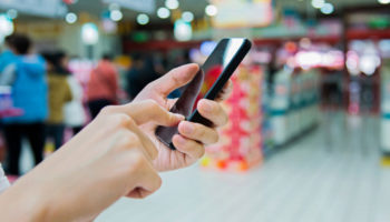 using smartphone in supermarket
